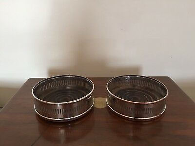 "Pair Of Pierced Silver Plated Wine Coasters With Wooden Bases 4.25"" In Diameter"