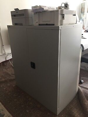 Large white office cabinet. lockable front door with one shelf. stoarge filing