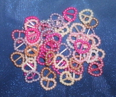 50 small Plastic buckles, doll sewing clothes crafts. Pearly pink cream hearts