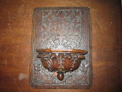 A curious old carved wooden panel