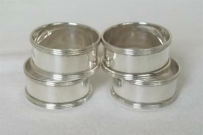 A Superb Set Of Four Solid Sterling Silver Napkin Rings London 1953.