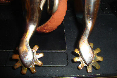 Pair of spurs with straps & buckles
