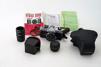 Fujica ST605N 35mm camera body, extension tubes, teleconverter, & Pentax Guide