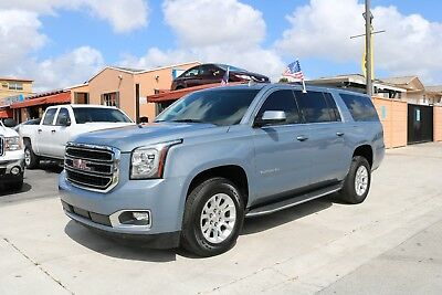 2016 GMC Yukon XL EIGHT PASSENGER / ALL WHEEL DRIVE / LOW MILES TEEL GRAY EXTERIOR OVER BLACK LEATHER - ONE OWNER - REAR CAMERA - BLIND SPOT