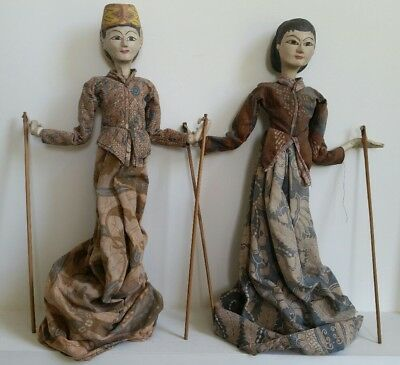 Two Antique handmade Balinese puppets in batik clothing