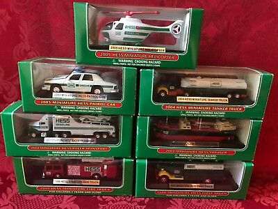 Set-(7) Hess Mini Trucks 1999-2005 Direct From The Factory Case-Mint