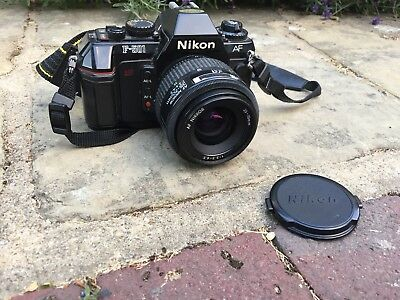 Nikon F-501 With Lens And In Great Working Order.