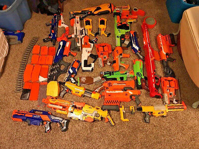 Huge lot of 26 Nerf guns Plus Extra accessories