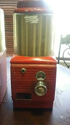 Vintage Red penny candy dispensor.