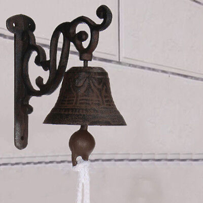 Vintage Antique Cast Iron Door Wall Bell Chime Wall Rust Garden Decoration Stock