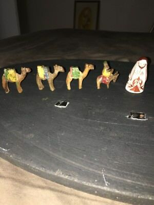 4 Beautiful Mini Hand Wooden Camels And 1 Unidentified Porcelain Man Piece