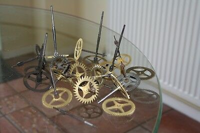 A vintage selection of 24 clockmakers cogs/gears excellent condition
