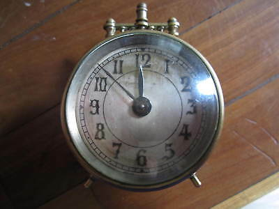 An old brass clock in working order