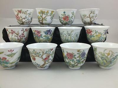 A Set Of 12 Chinese Porcelain Bowls Each With Various Flowers And Script 20Thc