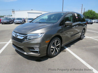 Honda Odyssey Elite Automatic Elite Automatic New 4 dr Van Automatic Gasoline 3.5L V6 Cyl Pacific Pewter Metal