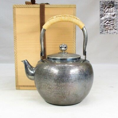 E524: Japanese kettle for tea ceremony of brass with stamp of pure silver