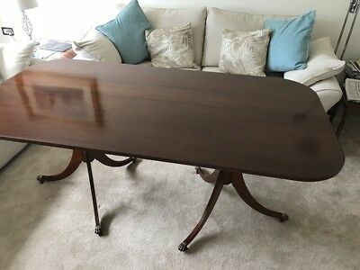 Reproduction 50 year old hand made solid mahogany dining table with brass feet.