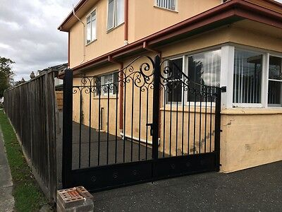 Made to order wrought iron double swinging driveway gates adjustable 3.9to 4.1m