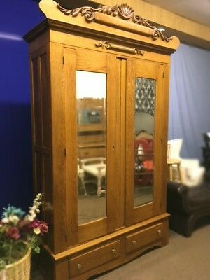 Antique Oak Armoire with Mirrored Doors and Carved Top, Breaks Down