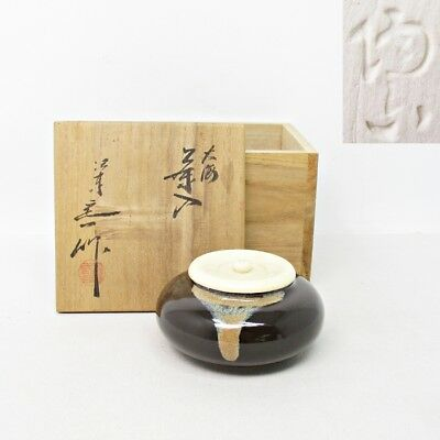 E915: Japanese tea caddy of porcelain ware with sign, resin lid and box