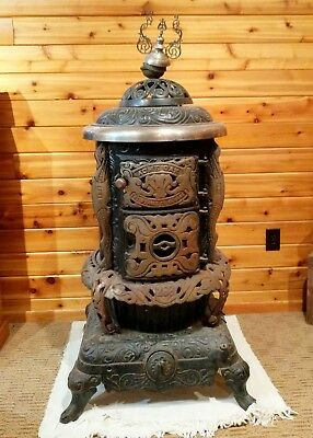 antique cast iron parlor stove; Wehrle 268 made in Newark NJ. Good condition.