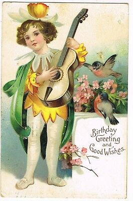 ANTIQUE EMBOSSED BIRTHDAY Postcard   BOY PLAYING GUITAR, DRESSED AS A FLOWER
