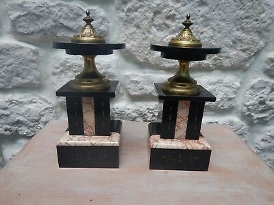 pair of small pans pendulum support fireplace marble