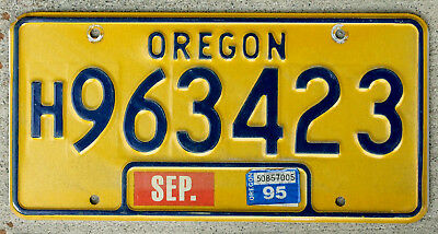 Classic Blue on Orange Oregon License Plate with a 1985 Sticker