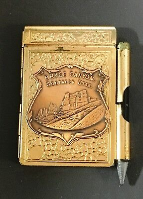 Vintage brass Jemco Hold A Note Bryce Canyon Utah on US Forest Service Shield