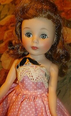 10-in vintage 1950s Toni doll, American Character, in tagged Vogue dress