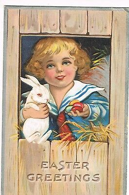 ANTIQUE EMBOSSED EASTER Postcard   CHILD HOLDING WHITE BUNNY, COLORED EGGS