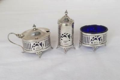 A Superb Solid Sterling Silver Pierced Three Piece Cruet Set Birmingham 1936.
