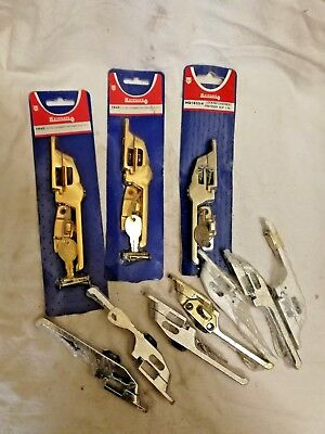 10 assorted window catches, including keys