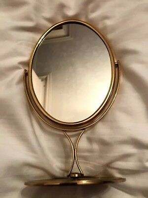Pretty, oval, gilt make-up mirror on stand. with butterfly pattern on rev