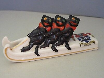 CRESTED CHINA - THREE BLACK CATS on a SLEDGE, CREST of TORQUAY