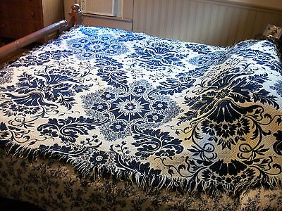 Early wool coverlet, navy and cream floral, seamed in middle, heirloom blanket
