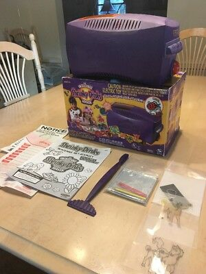 The incredible shrinky dinks maker trays/ push tool.