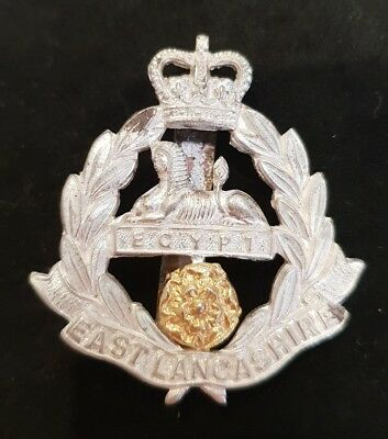 A British Army Cap Badge. East Lancashire Regiment with Queen's Crown.