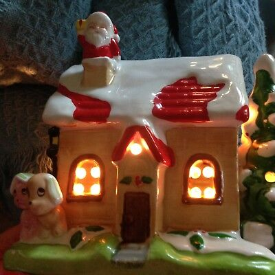 nos lighted christmas village house with santa dog and cat