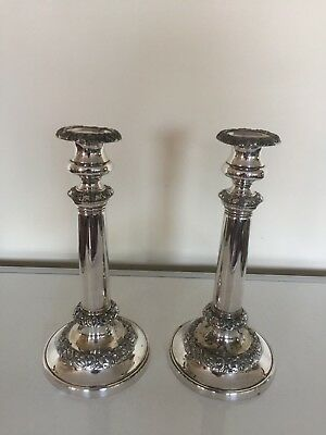 """PAIR OF SILVER PLATED CANDLESTICKS ON A FILLED CIRCULAR BASE 10.25"""" TAll"""