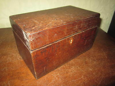 A Victorian oak tea caddy