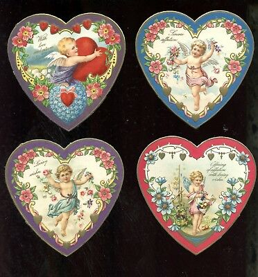 Early 1900's Antique Valentine Cupid Angels embossed paper hearts original scrap