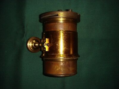 Antique brass camera/magic lantern lens