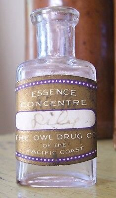 The Owl Drug Co. Pacific Coast Mini bottle Gold Paper label Owl mortar embossed