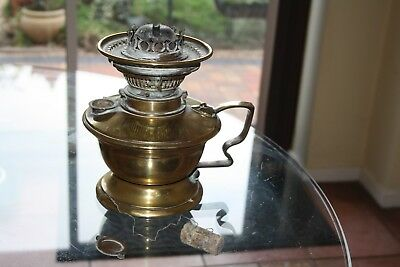 Antique Victorian brass oil lamp with a messengers burner excellent condition