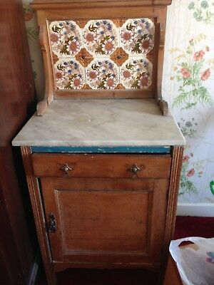 marble topped antique washstand with tiled splash back.