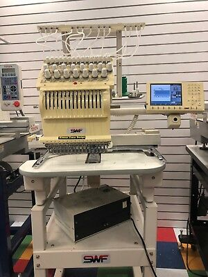 SWF 15 needle embroidery machine With Hoops threads and Dakota over 20000 design