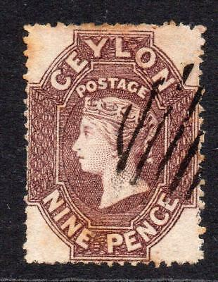 Ceylon 9 Pence Stamp c1861-64(SG25) Used (clean cut perf) (some tone and crease)