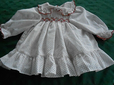 """''polly Flinders"""" Smocked Baby Dress In A White&red Polka Dot Cotton, Circa 1960"""