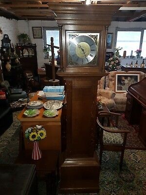 longcase clock oak cased with  8 day bar strike movement Westminster Chimes